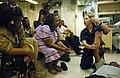 US Navy 050826-N-3455P-014 Disbursing Clerk 2nd Class Alexandria M. Dyer demonstrates first aid to citizens of Majuro aboard the amphibious assault ship USS Boxer (LHD 4).jpg