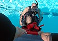 US Navy 051005-N-3019M-007 Boatswain's Mate 2nd Class Michael Santiago, assigned to the guided missile destroyer USS Paul Hamilton (DDG 60), prepares to lift a victim out of the water during a search and rescue swimmer dr.jpg