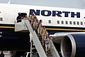 US Navy 060310-N-5681S-005 Sailors from Navy Expeditionary Logistics Support Group (NAVELSG), exit an airplane at the AMC Terminal at Naval Station Norfolk.jpg