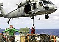 US Navy 060624-N-7981E-073 Aviation Ordnancemen from Weapons Department, G-1 Division attach a cargo pendant to an MH-60S Seahawk assigned to Helicopter Sea Combat Two One (HSC-21).jpg