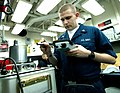 US Navy 070209-N-8146B-001 Aviation Electronics Technician 3rd Class Jonathan Alford stationed aboard the amphibious assault ship USS Boxer (LHD 4), calibrates a sensor used for engine maintenance.jpg