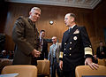 US Navy 070328-N-0696M-153 Chief of Naval Operations (CNO) Adm. Mike Mullen speaks with Commandant of the Marine Corps Gen. James T. Conway prior to testifying before the Senate Appropriations Committee on the 2008 National Def.jpg