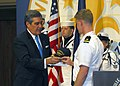 US Navy 070416-N-2903M-024 Lt. j.g. Patrick Muehr, the reactor controls assistant aboard fast attack submarine USS Louisville (SSN 724) presents Louisville Mayor Jerry Abramson a USS Louisville command ball cap.jpg