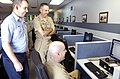 US Navy 070802-N-8467N-002 Sailors show Naval Submarine Base New London Commanding Officer, Capt. Mark Ginda, how easy it is to log on to a computer in the Naval Submarine Support Center (NSSC) Career Management Center at the c.jpg