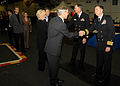 US Navy 071003-N-9898L-109 Rear Adm. Scott Van Buskirk, commander of Carrier Strike Group 9, and Capt. Patrick D. Hall, commanding officer of USS Abraham Lincoln (CVN 72), greet guests at a reception in Lincoln's hangar bay.jpg