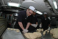 US Navy 071030-N-0167B-058 Culinary Specialist Seaman Brandon Freeman, of Lakeland, Fla., kneads dough into rolls in USS Kitty Hawk's bake shop.jpg