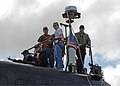 US Navy 080919-N-7668G-093 Cmdr. Troy Jackson, far right, commanding officer of the Los Angeles-class attack submarine USS Norfolk (SSN 714), stands on the bridge with two Tigers while the submarine prepares to go to sea for a.jpg