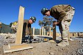 US Navy 090204-N-1509W-018 Builder 3rd Class Gary Lamew, from Kalamazoo, Mich., assigned to Amphibious Construction Battalion (ACB) 2, checks the level of a building foundation.jpg