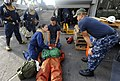 US Navy 090914-N-5345W-211 Hospital Corpsman 1st Class David Ancheta, right, asks Hospital Corpsman 2nd Class Ambar Vega what steps she'll take while responding to a simulated personnel casualty.jpg