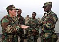 US Navy 100403-N-6138K-931 Capt. Cindy Thebaud, commander of Africa Partnership Station (APS) West, speaks to Armed Forces of Liberia Coast Guardsmen while transiting to the amphibious dock-landing ship USS Gunston Hall (LSD 44.jpg