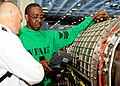 US Navy 100520-N-8913A-156 Aviation Machinist's Mate 1st Class Horace R. Cyrus performs an inspection on a jet engine inside the jet shop aboard USS George H.W. Bush (CVN 77).jpg
