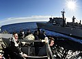 US Navy 110122-N-9811S-055 Sailors on the bridge of the guided-missile destroyer USS Barry (DDG 52) monitor a refueling at sea with the Military Se.jpg