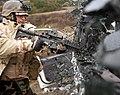 US Navy 110218-N-OT964-197 Mass Communication Specialist 3rd Class Jonathon Chandler breaks a window on a car during an ambush drill as part of a W.jpg