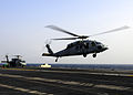 US Navy 110314-N-5503T-232 An MS-60S Sea Hawk helicopter assigned to the Wildcards of HSC-23 lifts off from the aircraft carrier USS Ronald Reagan.jpg