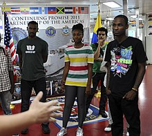 US Navy 110609-F-CF975-040 Hospital Corpsman 3rd Class Brent Snyder welcomes hip-hop band Chocquib Town to USNS Comfort (T-AH 20).jpg