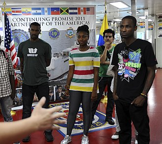 ChocQuibTown - Image: US Navy 110609 F CF975 040 Hospital Corpsman 3rd Class Brent Snyder welcomes hip hop band Chocquib Town to USNS Comfort (T AH 20)