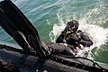 US Navy 110827-N-PB383-047 Chief Navy Diver Michael Hunt, assigned to Mobile Diving and Salvage Unit (MDSU) 1, dives into San Diego Bay to search f.jpg