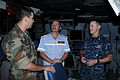 US Navy 111015-N-UE250-302 Russian Group Ship Commodore Sergey Jzuga talks with Cmdr. Steven DeMoss, commanding officer of the Arleigh Burke-class.jpg