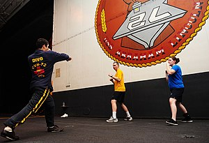 US Navy 111226-N-KQ415-237 Lt. Noel Rodriguez teaches mixed martial arts in the hangar bay of the Nimitz-class aircraft carrier USS Abraham Lincoln.jpg
