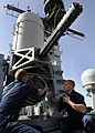 US Navy 120206-N-BC134-044 Sailors aboard the guided-missile cruiser USS Bunker Hill (CG 52) perform maintenance on a close-in weapons system.jpg