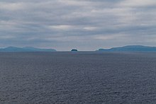 Umnak, Bogoslof and Unalaska Islands as seen from the Bering Sea looking south. Unalaska Island is on the left, Bogoslof Island is in the center, and Umnak Island is on the right.
