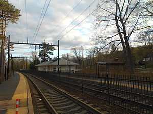Upper Montclair station - The Upper Montclair train station in April 2014. The new station, rebuilt from the 2006 fire, is visible on the right side of the platforms.
