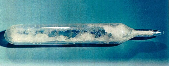 Snow-like substance in a sealed glass ampoule.