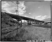 VIEW OF RAILROAD IN RELATION TO MCCAMMON BRIDGE, FACING NORTHWEST - McCammon Overhead and River Crossing Bridge, Interstate 15, Business, 3.3 mile post , McCammon, Bannock County, HAER ID,3-MCAM,1-6.tif