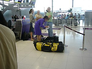 A female Thai Airways International employee a...
