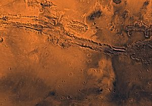 Coprates quadrangle - Image of the Coprates Quadrangle (MC-18). The prominent Valles Marineris chasma system intersects the moderately cratered northern part and the faulted highland ridged plains in the southern part.