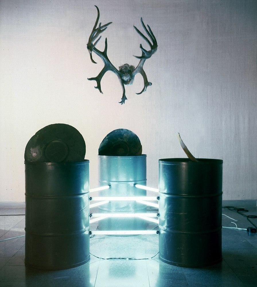 "Vasiliy Ryabchenko. ""Big Bembi"", installation, barrels, linear lamps, deer horns, 1994"