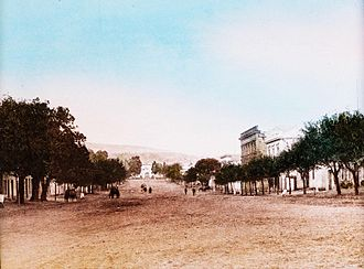 Rhodes University - View of High Street looking west from the corner of Hill Street towards the Drostdy Arch, the main entrance to the present-day Rhodes University campus. Circa 1898.