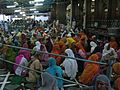 Volunteers helping at the Golden Temple langar, Sikhism in India.jpg