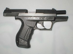 Walther P99 - Walther P99 with the slide locked back displaying its vertical barrel tilt.