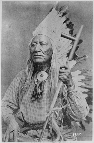 Eastern Shoshone - Image: Washakie (Shoots the Buffalo Running), a Shoshoni chief, half length, seated, holding pipe NARA 530875
