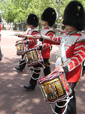 Band of the Welsh Guards - Three Drummers in the Welsh Guards band march up the Mall