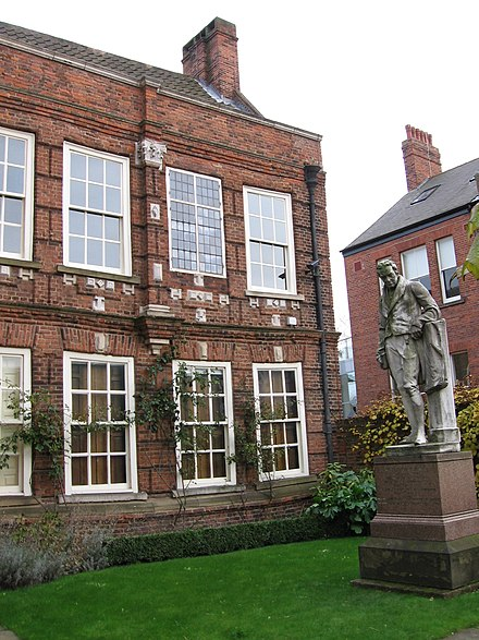 A statue of William Wilberforce outside Wilberforce House, his birthplace in Hull. Wilberforce House Hull.jpg