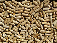 Wine bottle corks behind glass.jpg
