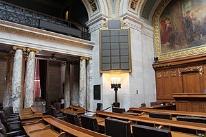 Voting methods in deliberative assemblies - The Wisconsin State Assembly chamber, with the electronic vote board on the wall. In 1917, the Wisconsin State Assembly became the first state legislative chamber to adopt an electronic voting system.