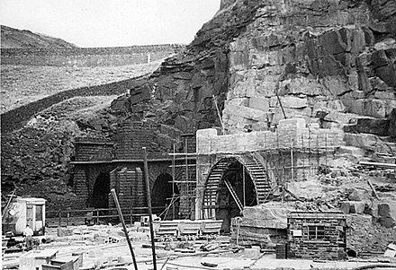 Photograph from 1953, showing the western portals of Woodhead 1&2 in the background, with Woodhead 3 under construction in the foreground Woodhead tunnels western portals 2048400.jpg