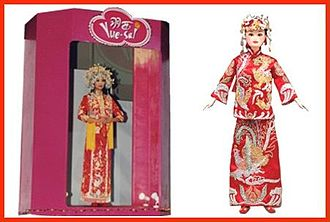 """Yue-Sai Kan - Yue-Sai designed and produced a line of Asian female dolls, known as the Yue-Sai WaWa (""""doll"""" in Chinese)."""