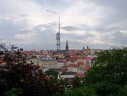 Žižkov as seen from Vítkov hill, with Žižkov Television Tower and St. Procopius church