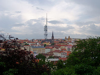 Žižkov - Žižkov as seen from Vítkov hill, with Žižkov Television Tower and St. Procopius church