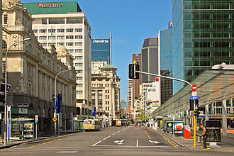 Britomart Transport Centre - Pre-2016 view southward up Queen Street. Britomart is at left, pedestrian canopy at right, QEII Square and Downtown Shopping Centre out of picture at right