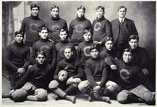 A football team picture, with men in sweaters