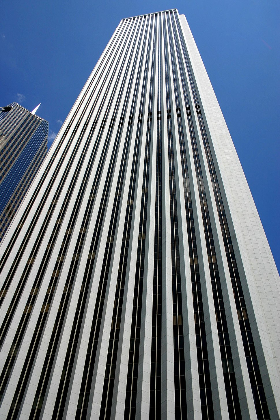 Aon Center in Chicago was the tallest structure clad in marble upon its completion. The marble however proved to be fragile, and the building was re-clad in a similarly-colored granite at an extreme financial cost.