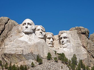 Historical rankings of presidents of the United States - In the 1920s, sculptor Gutzon Borglum and President Calvin Coolidge selected George Washington, Thomas Jefferson, Theodore Roosevelt and Abraham Lincoln to appear on Mount Rushmore—it later became an iconic symbol of presidential greatness.