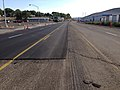 2014-09-09 09 02 49 Asphalt milled in preparation for new asphalt overlay with new overlay partially applied on Idaho Street (Interstate 80 Business and Nevada State Route 535) in Elko, Nevada.JPG
