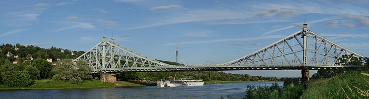 """The picture shows the Loschwitz Bridge """"The Blue Wonder"""" Dresden, Saxony, Germany.  The Blue Wonder is a so-called band-iron bridge. Here, the tensile forces are not transmitted by a cable or a chain, but of narrow metal strips which riveted together. These work like a rope. Since the concept has not prevailed, this bridge is an interesting historical and technical uniqueness."""