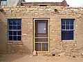 29 Acoma Pueblo yellow door and blue windows.jpg